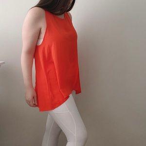 Orange chiffon tunic with crisscross open back